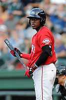 Franklin Guzman (10) of the Greenville Drive bats in a game against the Augusta GreenJackets on Friday, July 11, 2014, at Fluor Field at the West End in Greenville, South Carolina. Greenville won, 7-6. (Tom Priddy/Four Seam Images)