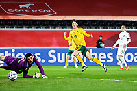 24th March 2021; Leuven, Belgium; Thibaut Courtois goalkeeper of Belgium beaten by Harry Wilson of Wales who scores his goal during the Qatar 2022 Qualifiers Match between Belgium and Wales on March 24, 2021 in Leuven, Belgium