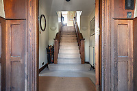 BNPS.co.uk (01202) 558833.<br /> Pic: CarterJonas/BNPS<br /> <br /> Pictured: Entrance hall and stairs. <br /> <br /> The former family home of Lord of the Flies author William Golding has gone on sale for £1m.<br /> <br /> The Grade II Listed cottage on a green in Marlborough is said to have inspired some of the Nobel Prize winning writer's work.<br /> <br /> His parents Alec, a teacher, and Mildred, a suffragette, bought the house and moved there in 1905, when Mr Golding obtained a job at the town's grammar school.<br /> <br /> Sir William was born in 1911 and he and his brother lived in the property and its location influenced his writing. He wrote of the property: 'Our house was on the green, that close like square, tilted south'.
