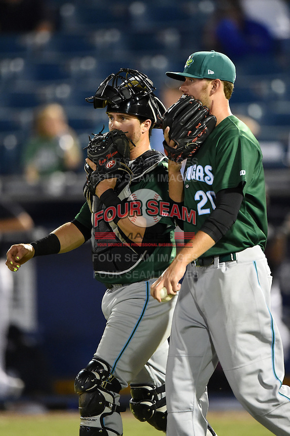 Daytona Tortugas catcher Cam Maron (7) talks with pitcher Joel Bender (20) during a game against the Tampa Yankees on April 24, 2015 at George M. Steinbrenner Field in Tampa, Florida.  Tampa defeated Daytona 12-7.  (Mike Janes/Four Seam Images)