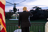 President Trump Returns to the White House<br /> <br /> President Donald J. Trump salutes Marine One from the Blue Room Balcony of the White House Monday, Oct. 5, 2020, following his return from Walter Reed National Military Medical Center in Bethesda, Md. (Official White House Photo by Andrea Hanks)