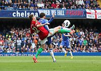 Pictured: Angel Rangel tackles Eden hazard<br /> Barclays Premier League, Chelsea FC (blue) V Swansea City,<br /> 28/04/13