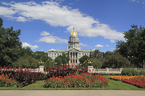 Colorado State Capitol and flower gardens in Civic Center Park, downtown Denver, Colorado, USA .  John offers private photo tours in Denver, Boulder and throughout Colorado. Year-round Colorado photo tours.