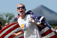 USA fan celebrates a goal while watching the finals of the 2011 FIFA Women's World Cup prior to a Women's Professional Soccer (WPS) match between Sky Blue FC and the Western New York Flash at Yurcak Field in Piscataway, NJ, on July 17, 2011.