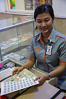Yogyakarta, Java, Indonesia.  Post Office Employee and Stamps.