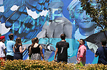Mark Salinas, Carson City's arts and culture coordinator, right center, takes a group of Boys & Girls Club members on a tour of local murals in Carson City, Nev., on Monday, July 31, 2017. <br />Photo by Cathleen Allison/Nevada Photo Source