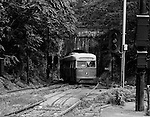 Pittsburgh PA:  View of the Knoxville Street Car (Trolley) emerging from the Mount Washington Tunnel into the South Hills Junction.  In the early 1960s, Pittsburgh had the largest surviving streetcar system in the United States. The Pittsburgh Railways Company operated more than 600 PCC cars on 41 routes. In 1964 the system was acquired by the Port Authority of Allegheny County, which rapidly converted to buses. By the early 1970s, only a handful of streetcar routes remained, most of which used the Mt. Washington Tunnel just south of the Monongahela River to reach the South Hills area.