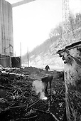 Kopperstown, West Virginia.USA .January 17, 2005..Savaging metal at an abandon coal mine.