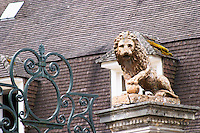 On the wall surrounding the house mansion a stone statue of a lion with a its paw on a cannon ball, Champagne Jacquesson in Dizy, Vallee de la Marne, Champagne, Marne, Ardennes, France