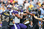Washington Huskies linebacker Travis Feeney (41) and Southern Miss Golden Eagles running back Tez Parks (8) in action during the Zaxby's Heart of Dallas Bowl game between the Washington Huskies and the Southern Miss Golden Eagles at the Cotton Bowl Stadium in Dallas, Texas.