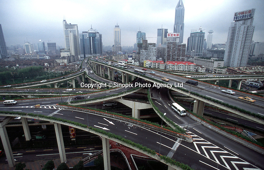 The spidery elevated highway system of Shangahi, China. As more people own cars in the city, more roads are needed as well..