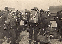 BNPS.co.uk (01202 558833)<br /> Pic: HannBooks/BNPS<br /> <br /> PICTURED: Gearing up for the jump, Harry Shanley and fellow troops.<br /> <br /> Remarkable photos taken deep behind enemy lines by an SAS unit during a daring wartime operation have come to light on the 75th anniversary of the mission. <br />  <br /> The little-known Operation Galia on the 27th December 1944 involved just 33 SAS men hoodwinking the Nazis and their fascist allies into thinking a much greater force had landed behind them in Italy in December 1944.<br />  <br /> Adolf Hitler's forces had just launched a major surprise offensive in the Ardennes Forest in Belgium that became known as the Battle of the Bulge.<br /> <br /> Robert Hann, whose late father was SAS Paratrooper Stanley Hann, retraced his father's wartime experiences and part of his [father's] epic 80 mile long escape route through the Apennine mountains which the men took, to help him write the book 'SAS Operation Galia.'