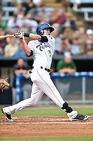 Asheville Tourists center fielder David Dahl #21 swings at a pitch during a game against the Savannah Sand Gnats at McCormick Field September 3, 2014 in Asheville, North Carolina. The Tourists defeated the Sand Gnats 8-3. (Tony Farlow/Four Seam Images)