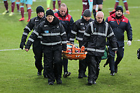 Medical staff carry on a stretcher Winston Reid of West Ham who was injured during the Premier League match between Swansea City and West Ham United at The Liberty Stadium, Swansea, Wales, UK. Saturday 03 March 2018