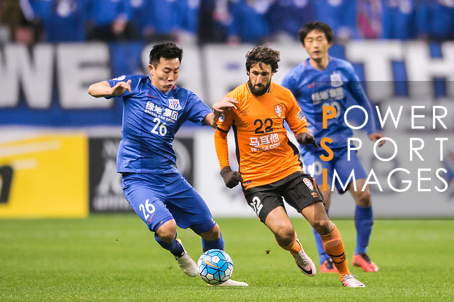 Qin Sheng (l) of Shanghai Shenhua FC fights for the ball with Thomas Broich of Brisbane Roar during their AFC Champions League 2017 Playoff Stage match between Shanghai Shenhua FC (CHN) and Brisbane Roar (AUS) at the Hongkou Stadium, on 08 February 2017 in Shanghai, China. Photo by Marcio Rodrigo Machado / Power Sport Images