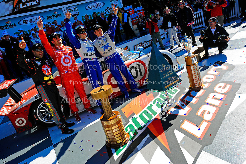 The winners in Victory Lane (L to R):  Juan Pablo Montoya, Dario Franchitti, Memo Rojas and Scott Pruett.