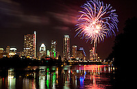 Fireworks light up the night sky on the 4th of July over Town Lake and Congress Bridge, Austin, Texas
