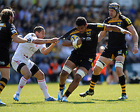 Julien Arias of Stade Francais hangs onto the shirt of Nathan Hughes of London Wasps during the first leg of the European Rugby Champions Cup play-off match between London Wasps and Stade Francais at Adams Park on Sunday 18th May 2014 (Photo by Rob Munro)