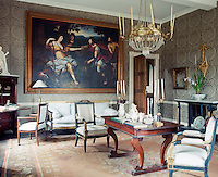 Taupe damask covers the walls of this sitting room and a large painting depicting Diana (goddess of hunting) dominates the wall above the sofa