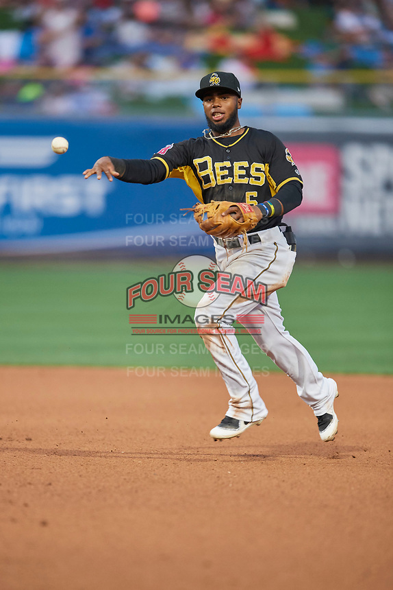 Luis Rengifo (5) of the Salt Lake Bees throws to first base against the El Paso Chihuahuas at Smith's Ballpark on August 14, 2018 in Salt Lake City, Utah. El Paso defeated Salt Lake 6-3. (Stephen Smith/Four Seam Images)