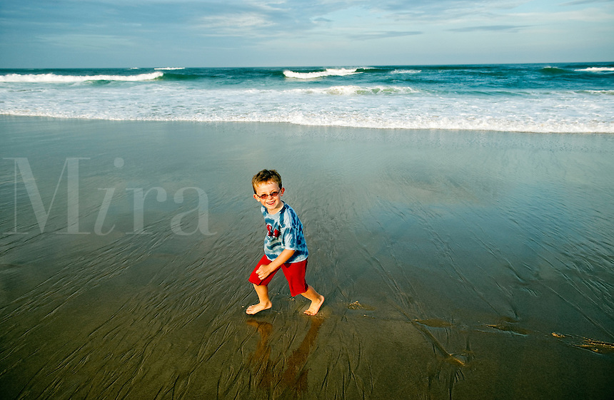 Boy playing at the beach.