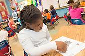 MR / Schenectady, New York. Yates Arts-in-Education Magnet School (urban public school). First grade classroom. Student (girl, 6) taking test. MR: Bel5. ID: AM-g1w. © Ellen B. Senisi.