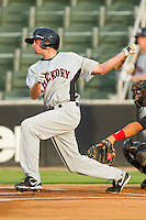 Jonathan Roof #14 of the Hickory Crawdads follows through on his swing against the Kannapolis Intimidators at Fieldcrest Cannon Stadium August 18, 2010, in Kannapolis, North Carolina.  Photo by Brian Westerholt / Four Seam Images