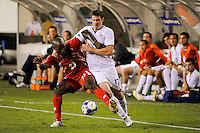Kenny Cooper (17) of the United States (USA) and Felipe Baloy (23) of Panama battle for the ball. The United States (USA) defeated Panama (PAN) 2-1 during a quarterfinal match of the CONCACAF Gold Cup at Lincoln Financial Field in Philadelphia, PA, on July 18, 2009.