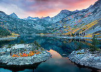 Lake Sabrina at sunset with fall colored aspens. Inyo National Forest. California