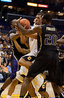 Jamal Boykin grabs the rebound against Quincy Pondexter. The Washington Huskies defeated the California Golden Bears 79-75 during the championship game of the Pacific Life Pac-10 Conference Tournament at Staples Center in Los Angeles, California on March 13th, 2010.