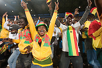 Ghana fans cheer after Ghana scoring a goal during their first round match of against Serbia at Loftus Versfeld Stadium in Pretoria, South Africa on Saturday, June 12, 2010.  Ghana defeated Serbia on a penalty kick goal 1-0.