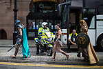 © Joel Goodman - 07973 332324. 30/07/2017 . Manchester , UK . A motorbike policeman watching over the crowds at the venue . Cosplayers, families and guests at Comic Con at the Manchester Central Convention Centre . Photo credit : Joel Goodman