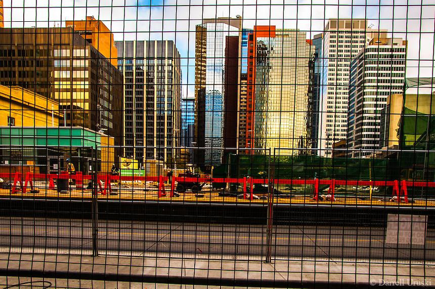 Abstract photograph of office towers in a construction zone that have perfect lighting.