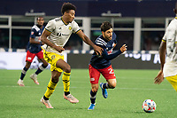 FOXBOROUGH, MA - MAY 16: Carles Gil #22 of New England Revolution breaks from Saad Abdul-Salaam #26 Columbus SC near the Columbus SC goal during a game between Columbus SC and New England Revolution at Gillette Stadium on May 16, 2021 in Foxborough, Massachusetts.