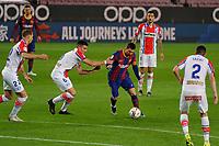 13th February 2021; Camp Nou, Barcelona, Catalonia, Spain; La Liga Football, Barcelona versus Deportivo Alaves; Leo Messi FC Barcelona  breaks past Battaglia of Deportivo on his way to goal