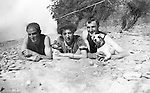 North East PA:  View of Brady, Clark and Peppy Stewart along with Aunt Maggie laying on the rocky shore of Lake Erie.