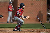 Evan Pietronico (4) of the NJIT Highlanders flip his bat as he follows through on his swing against the High Point Panthers at Williard Stadium on February 18, 2017 in High Point, North Carolina. The Panthers defeated the Highlanders 11-0 in game one of a double-header. (Brian Westerholt/Four Seam Images)