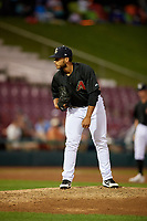 Kane County Cougars relief pitcher Abraham Almonte (11) looks in for the sign during a game against the South Bend Cubs on July 21, 2018 at Northwestern Medicine Field in Geneva, Illinois.  South Bend defeated Kane County 4-2.  (Mike Janes/Four Seam Images)