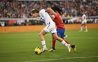JACKSONVILLE, FL - NOVEMBER 10: Tobin Heath #17 of the United States attempts to move past Shirley Cruz #10 of Costa Rica during a game between Costa Rica and USWNT at TIAA Bank Field on November 10, 2019 in Jacksonville, Florida.