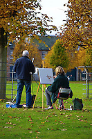 Two artists painting and drawing, Dunham Massey, Trafford, Greater Manchester.