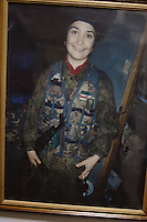Portrait of a smiling Chechen freedom fighter on the corridor of the ChRI representative office in the  Palace of Science and Culture in Warsaw.