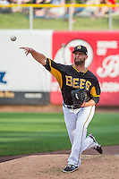 Steven Hensley (11) of the Salt Lake Bees warms up in the bullpen prior to the Pacific Coast League game against the Albuquerque Isotopes at Smith's Ballpark on June 8, 2015 in Salt Lake City, Utah.  The Isotopes defeated the Bees 8-7 in game two of a double-header. (Stephen Smith/Four Seam Images)