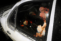 The five members of the Petty family wait in their car as the outside temperature drops to -10 degrees celsius. They will spend the night outside the mobile clinic so as not to miss the opportunity to get free dental and optical care. .Over the weekend at Soft Shell, Knott County, in the Appalachian mountains of eastern Kentucky, the congressional district with the nation's lowest life expectancy, RAM volunteers saw 822 needy people. 95 percent of people seen were provided with dental or optical care. RAM was founded in 1985 to provide free health, dental and eye care in the developing world. However, RAM now provides 60 percent of its services in the US, providing for the estimated 47 million Americans without health insurance..