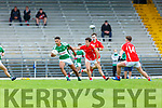 Jamie Alade Legion breaks away from Paudie O'Leary East Kerry during their County Minor Championship semi final in Fitzgerald stadium on Monday evening
