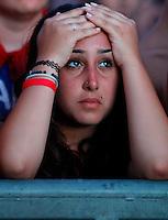 Calcio: Una tifosa della Nazionale italiana si rattrista mentre guarda la Finale dei Campionati Europei tra Italia e Spagna sui maxi schermi allestiti al Circo Massimo. La Spagna ha vinto 4-0. Roma, 1 luglio 2012. .Football: An Italian fans reacts at the Circus Maximus in Rome as she watchs the Euro 2012 Football Championship Final match between Italy and Spain  on a big screen. Spain won 4-0. .Rome, July 1, 2012. .UPDATE IMAGES PRESS