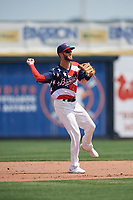 Quad Cities River Bandits shortstop David Hensley (15) throws to first base during a game against the West Michigan Whitecaps on July 23, 2018 at Modern Woodmen Park in Davenport, Iowa.  Quad Cities defeated West Michigan 7-4.  (Mike Janes/Four Seam Images)