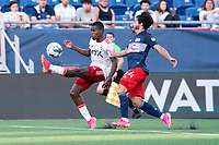 FOXBOROUGH, MA - JUNE 26: Bernard Kamungo #7 of North Texas SC takes a high ball as Ryan Spaulding #34 of the New England Revolution pressures during a game between North Texas SC and New England Revolution II at Gillette Stadium on June 26, 2021 in Foxborough, Massachusetts.