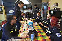 Switzerland. Canton Ticino. Pregassona. Croce Verde Lugano Headquarters. Team paramedics enjoys a breakfast together on a Saturday morning.The paramedics wear blue uniforms and work for theCroce Verde Lugano. Some are professional certified nurses, others are volunteers specifically trained in emergency rescue.TheCroce Verde Lugano is a private organization which ensure health safety by addressing different emergencies services and rescue services. Volunteering is generally considered an altruistic activity where an individual provides services for no financial or social gain to benefit another person, group or organization. Volunteering is also renowned for skill development and is often intended to promote goodness or to improve human quality of life. Pregassona is a quarter of the city of Lugano. 27.01.2018 © 2018 Didier Ruef