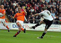 ATTENTION SPORTS PICTURE DESK<br /> Pictured: Craig Beattie of Swansea (R) shoots off target while closely marked by Marcel Seip (L)<br /> Re: Coca Cola Championship, Swansea City Football Club v Blackpool at the Liberty Stadium, Swansea, south Wales. Saturday 24 October 2009