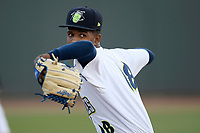 Starting pitcher Daison Acosta (18) of the Columbia Fireflies warms up before a game against the Rome Braves on Saturday, August 17, 2019, at Segra Park in Columbia, South Carolina. Rome won, 4-0. (Tom Priddy/Four Seam Images)